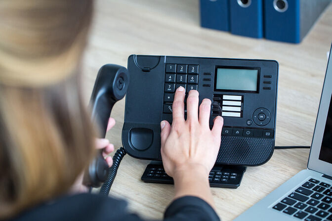 Woman types on a phone